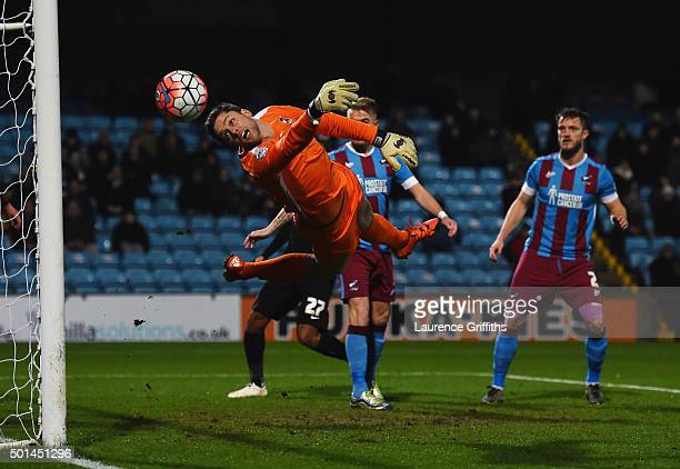Luke Daniels of Scunthorpe United makes a diving save during The Emirates FA Cup Second Round Replay between Scunthorpe United and Leyton Orient at...