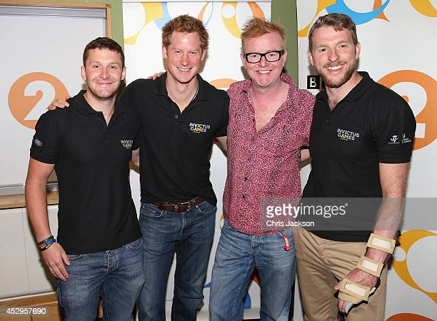 Luke Darlington Prince Harry Chris Evans and JJ Chalmers pose for a photograph at BBC Radio 2 Studios on July 30 2014 in London England Chris Evans...