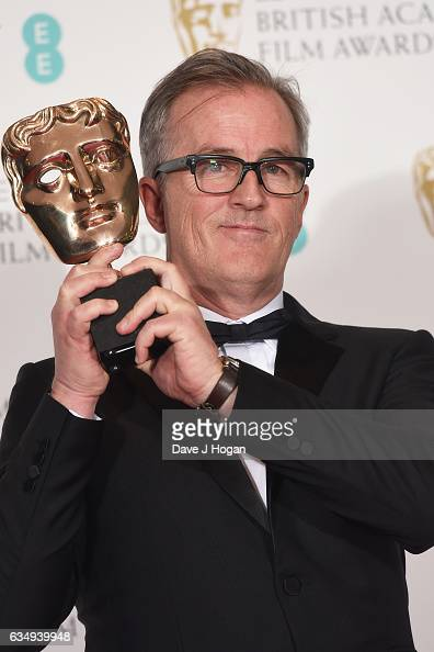 Luke Davies poses with his award for Adapted Screenplay for the film 'Lion' in the winners room at the 70th EE British Academy Film Awards at Royal...