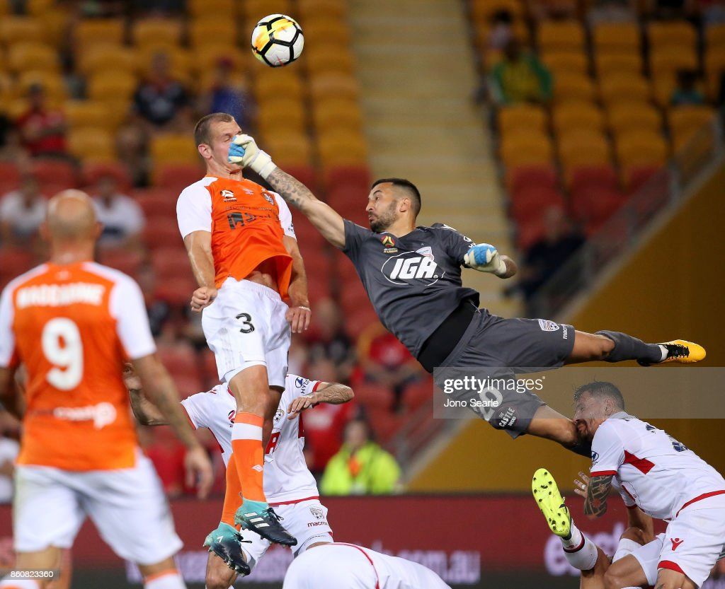 Luke De Vere of Brisbane and Paul Izzo of Adelaide clash during the round two A-League match between the Brisbane Roar and Adelaide United at Suncorp Stadium on October 13, 2017 in Brisbane, Australia.