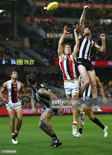 Luke Dempster of the Saints and Tyson Goldsack of the Magpies challenge eachother for the ball during the round three AFL match between the...