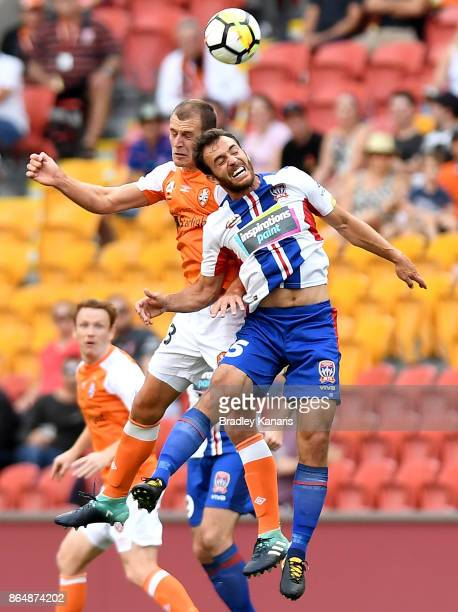 Luke DeVere of the Roar and Benjamin Kantarovski of the Jets challenge for the ball during the round three ALeague match between the Brisbane Bullets...