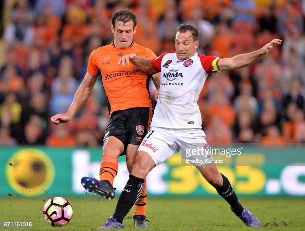 Luke DeVere of the Roar and Brendan Santalab of the Wanderers challenge for the ball during the ALeague Elimination Final match between the Brisbane...