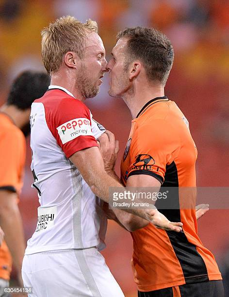 Luke DeVere of the Roar and Mitch Nichols of the Wanderers face off as tempers flare during the round 22 ALeague match between Brisbane Roar and...