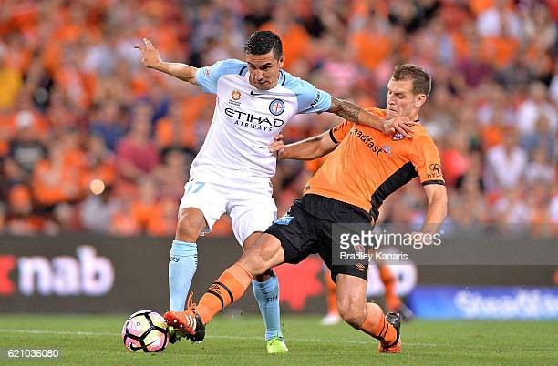 Luke DeVere of the Roar tackles Tim Cahill of Melbourne City during the round five ALeague match between the Brisbane Roar and Melbourne City FC at...