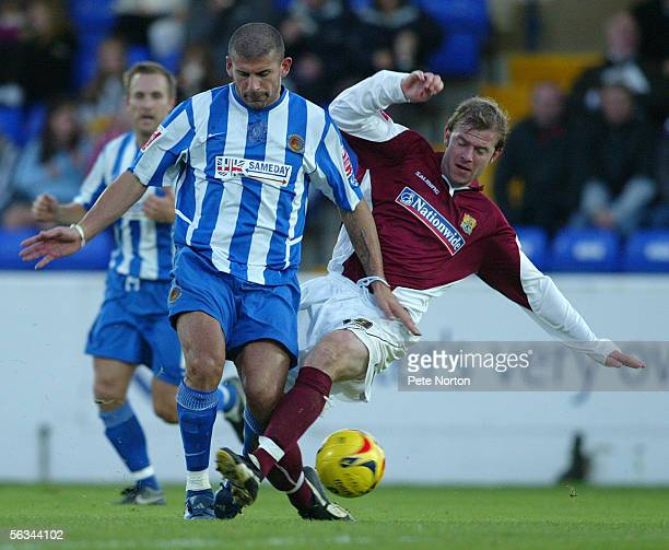 Luke Dimech of Chester City battles with Martin Smith of Northampton Town during the Coca Cola League Two match between Chester City and Northampton...