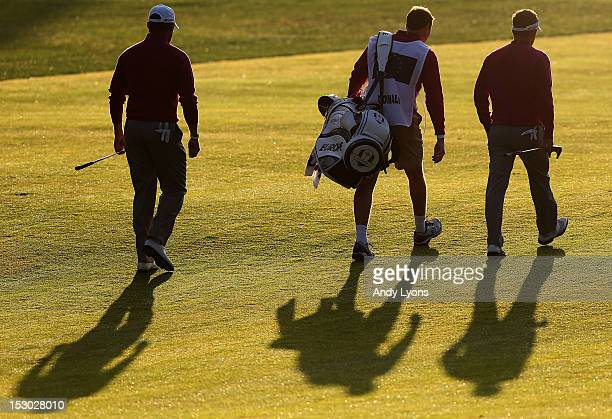 Luke Donald and Lee Westwood of Europe walk to the first green during day two of the Morning Foursome Matches for The 39th Ryder Cup at Medinah...