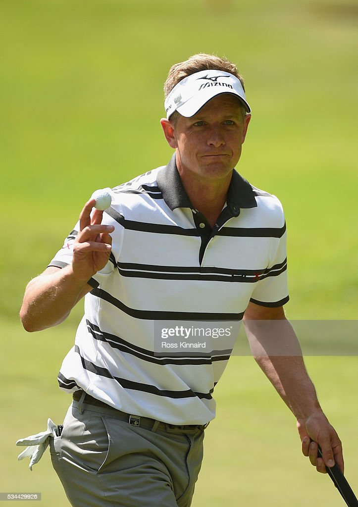 Luke Donald of England acknowledges the crowd on the 13th green during day one of the BMW PGA Championship at Wentworth on May 26, 2016 in Virginia Water, England.