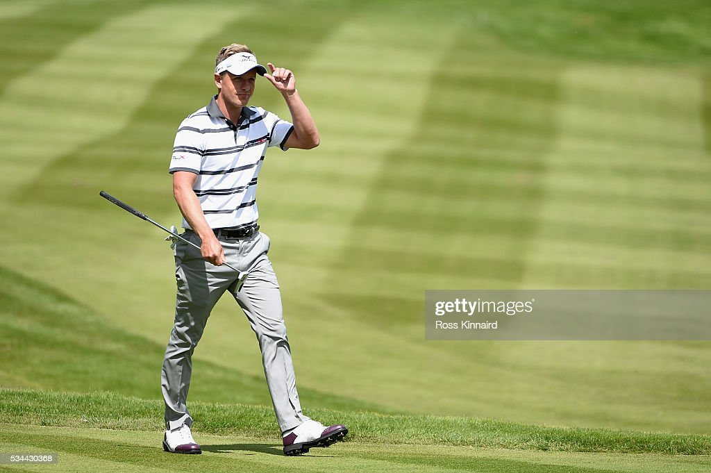 <a gi-track='captionPersonalityLinkClicked' href=/galleries/search?phrase=Luke+Donald&family=editorial&specificpeople=194977 ng-click='$event.stopPropagation()'>Luke Donald</a> of England acknowledges the crowd on the 18th green during day one of the BMW PGA Championship at Wentworth on May 26, 2016 in Virginia Water, England.