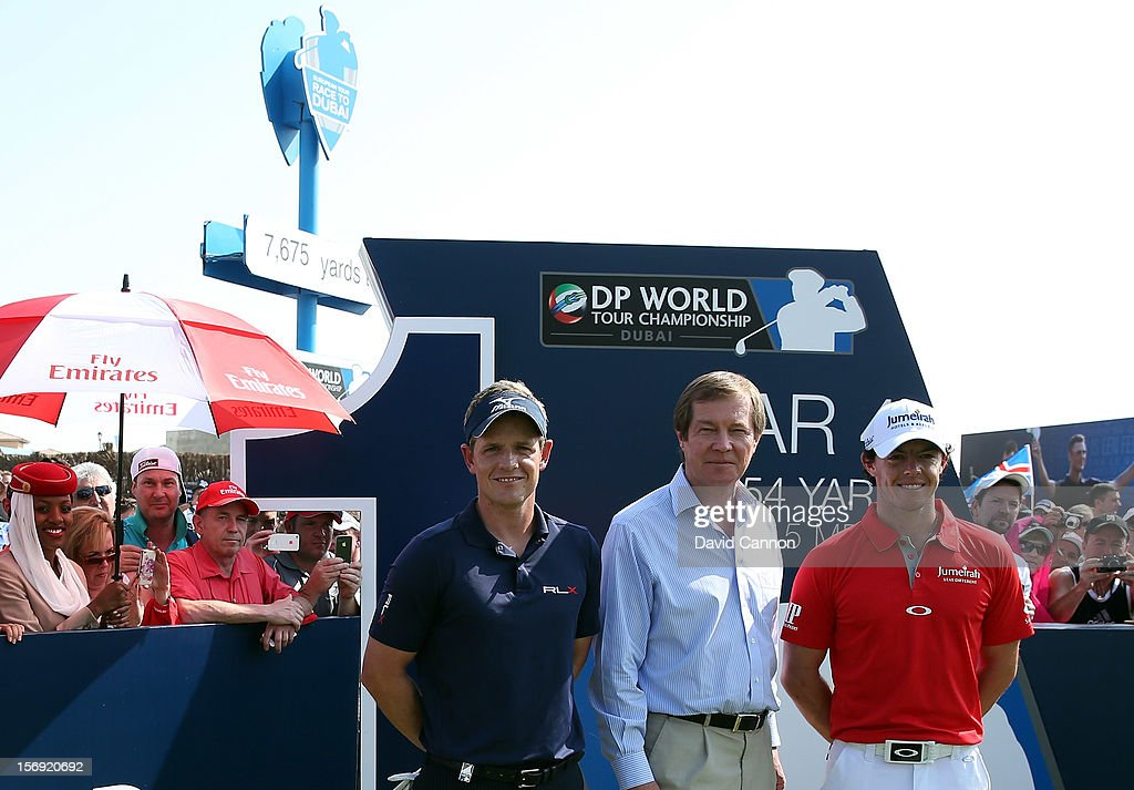 Luke Donald of England (l) and Rory McIlroy of Northern Ireland (r) the world's top two golfers are welcomed to the tee by George O'Grady The Chief Executive Officer of the European Tour (c) during the final round of the 2012 DP World Tour Championship on the Earth Course at Jumeirah Golf Estates on November 25, 2012 in Dubai, United Arab Emirates.