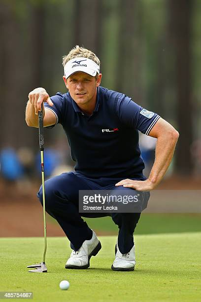 Luke Donald of England assesses a putt on the 2nd green during the final round of the RBC Heritage at Harbour Town Golf Links on April 20 2014 in...