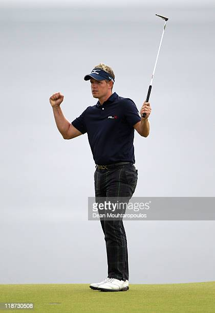 Luke Donald of England celebrates victory on the 18th green during the final round of The Barclays Scottish Open at Castle Stuart Golf Links on July...