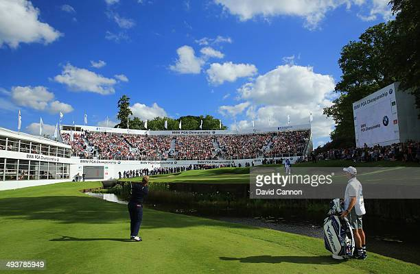 Luke Donald of England chips to the 18th green during day four of the BMW PGA Championship at Wentworth on May 25 2014 in Virginia Water England