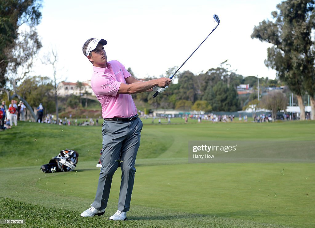 Luke Donald of England chips to the first green during the third round of the Northern Trust Open at the Riviera Country Club on February 16, 2013 in Pacific Palisades, California.