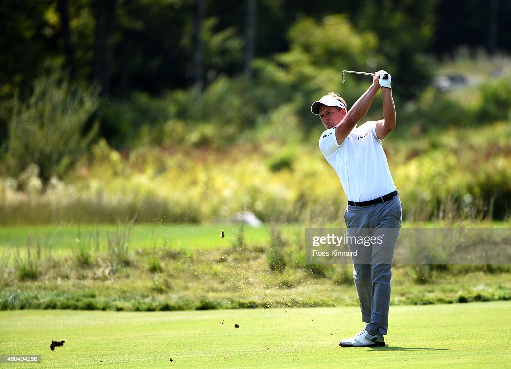 Luke Donald of England hist his second shot on the eighteenth fairway during round one of the Deutsche Bank Championship at TPC Boston on September 4, 2015 in Norton, Massachusetts.