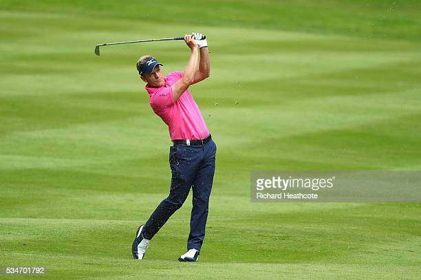 Luke Donald of England hits his 2nd shot on the 12th hole during day two of the BMW PGA Championship at Wentworth on May 27 2016 in Virginia Water...