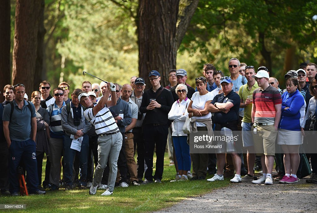 <a gi-track='captionPersonalityLinkClicked' href=/galleries/search?phrase=Luke+Donald&family=editorial&specificpeople=194977 ng-click='$event.stopPropagation()'>Luke Donald</a> of England hits his 2nd shot on the 14th hole during day one of the BMW PGA Championship at Wentworth on May 26, 2016 in Virginia Water, England.