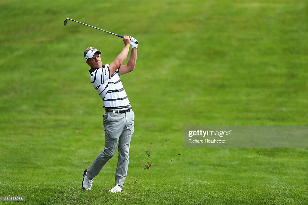 <a gi-track='captionPersonalityLinkClicked' href=/galleries/search?phrase=Luke+Donald&family=editorial&specificpeople=194977 ng-click='$event.stopPropagation()'>Luke Donald</a> of England hits his 2nd shot on the 4th hole during day one of the BMW PGA Championship at Wentworth on May 26, 2016 in Virginia Water, England.