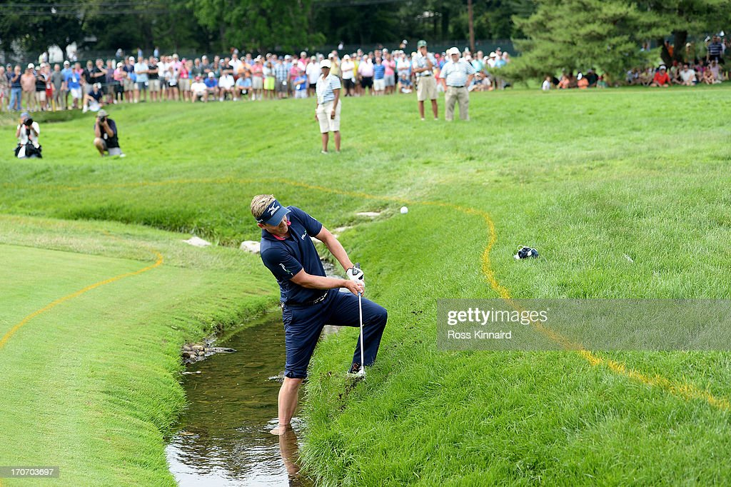 Luke Donald of England hits his fourth shot on the fourth hole during the final round of the 113th US Open at Merion Golf Club on June 16 2013 in...