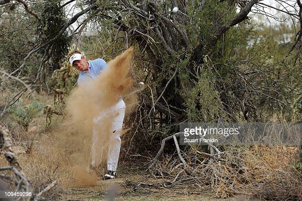 Luke Donald of England hits his second shot on the 11th hole during the semifinal round of the Accenture Match Play Championship at the RitzCarlton...