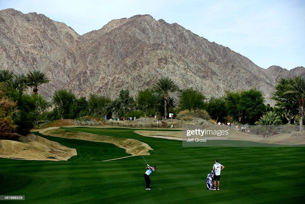 Luke Donald of England hits his second shot on the 15th fairway during round one of the Humana Challenge in partnership with The Clinton Foundation...