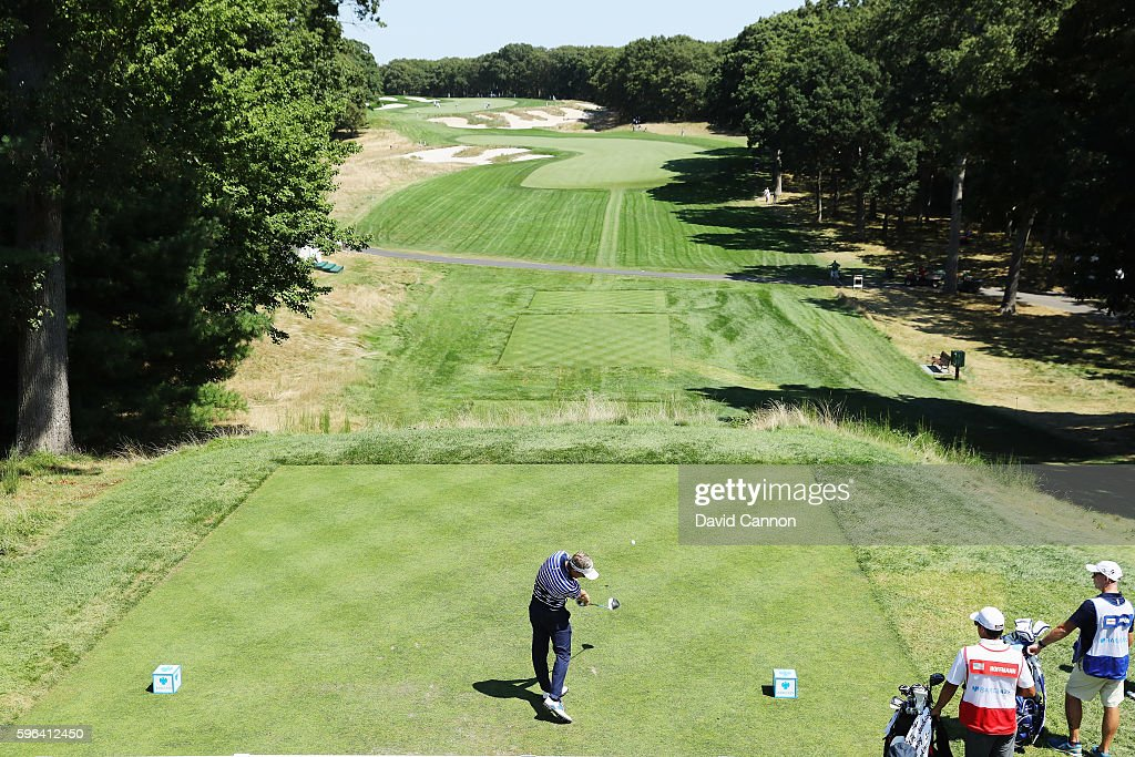 Luke Donald of England hits his tee shot on the fourth hole during the third round of The Barclays in the PGA Tour FedExCup Play-Offs on the Black Course at Bethpage State Park on August 27, 2016 in Farmingdale, New York.