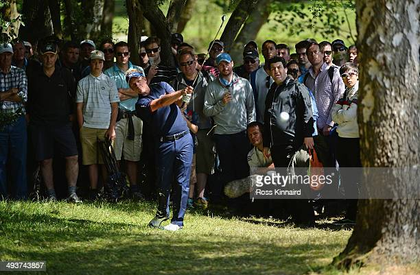 Luke Donald of England hits his third shot on the 6th hole during day four of the BMW PGA Championship at Wentworth on May 25 2014 in Virginia Water...