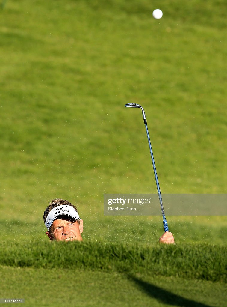 <a gi-track='captionPersonalityLinkClicked' href=/galleries/search?phrase=Luke+Donald&family=editorial&specificpeople=194977 ng-click='$event.stopPropagation()'>Luke Donald</a> of England hits out of a bunker on the 14th hole during the first round of the Northern Trust Open at Riviera Country Club on February 14, 2013 in Pacific Palisades, California. The shot went in the hole for a birdie two.