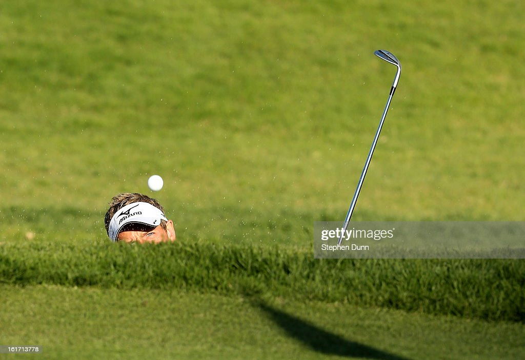 Luke Donald of England hits out of a bunker on the 14th hole during the first round of the Northern Trust Open at Riviera Country Club on February 14, 2013 in Pacific Palisades, California. The shot went in the hole for a birdie two.