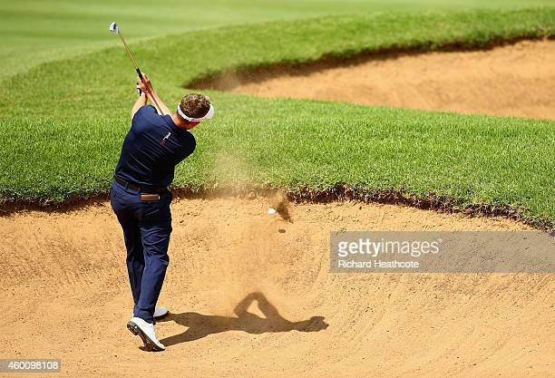 Luke Donald of England hits the lip of a fairway bunker on the 10th leaving his ball in the sand during the final round of the Nedbank Golf Challenge...