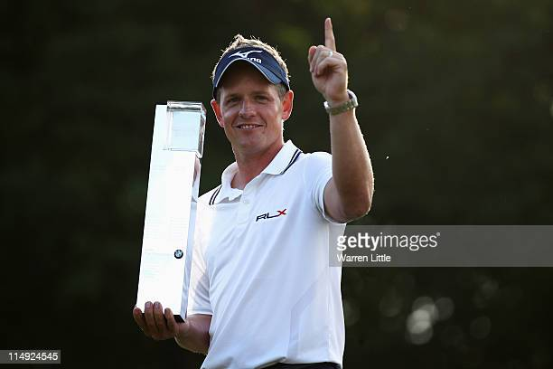 Luke Donald of England holds the trophy following his victory in a playoff on the 18th green which also secured him the Number one World ranking...