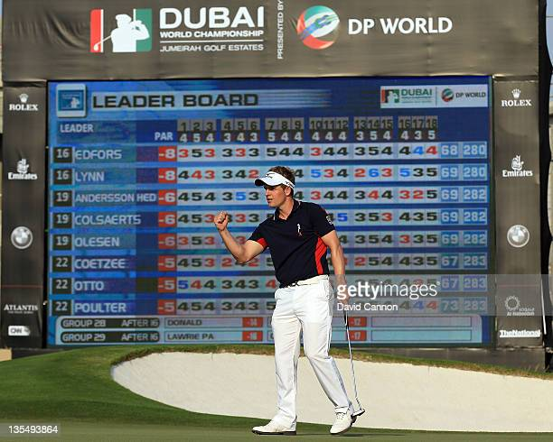 Luke Donald of England holes a birdie putt at the par 3 17th hole during the final round of the Dubai World Championship on the Earth Course at the...