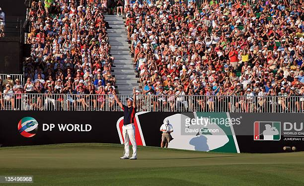Luke Donald of England holes a birdie putt at the par 5 18th hole to finish in third place that secured his Race to Dubai title during the final...