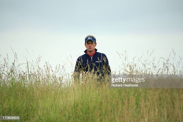 Luke Donald of England looks at the 12th green from the rough during the first round of the Alstom Open de France at Le Golf National on July 4 2013...