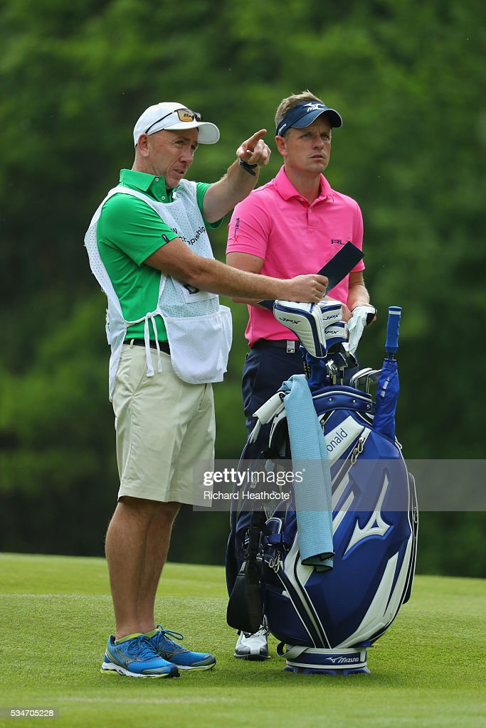 Luke Donald of England looks on with his caddie during day two of the BMW PGA Championship at Wentworth on May 27, 2016 in Virginia Water, England.