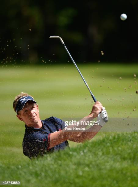 Luke Donald of England plays a bunker shot on the 6th hole during day four of the BMW PGA Championship at Wentworth on May 25 2014 in Virginia Water...