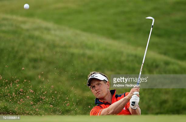 Luke Donald of England plays a bunker shot on the second hole during the Pro Am prior to the start of the Celtic Manor Wales Open on The Twenty Ten...