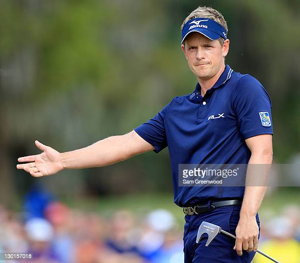 Luke Donald of England plays a shot on the 18th hole during the final round of the Children's Miracle Network Classic at Disney's Magnolia course on...