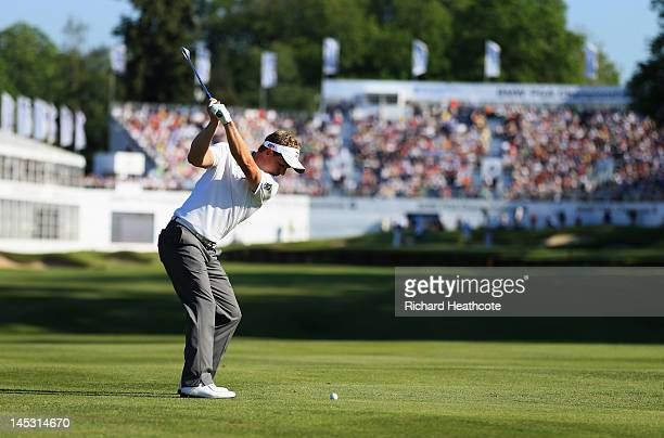 Luke Donald of England plays a shot on the 18th hole during the third round of the BMW PGA Championship on the West Course at Wentworth on May 26...