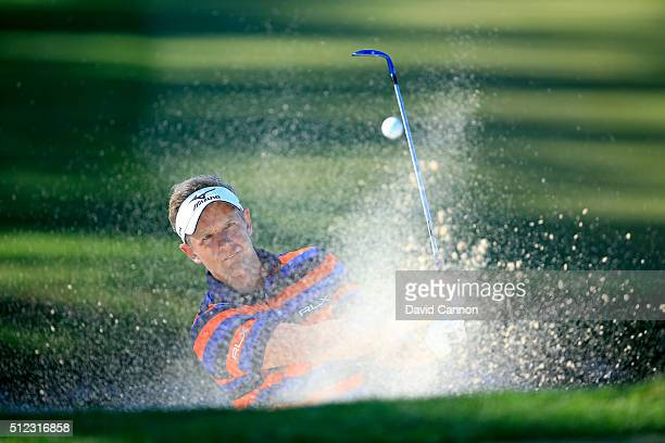 Luke Donald of England plays his fourth shot at the par 5 third hole during the first round of the 2016 Honda Classic held on the PGA National Course...