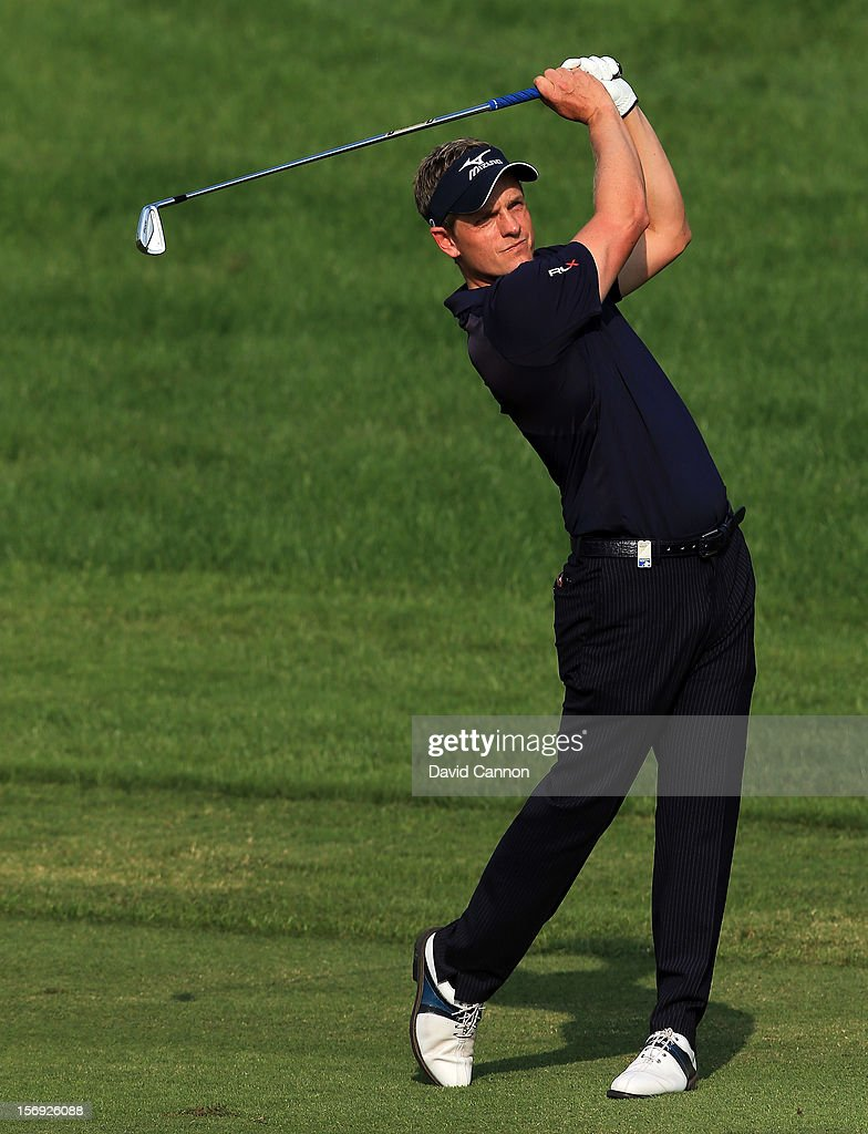 Luke Donald of England plays his second shot at the par 5, 14th hole during the final round of the 2012 DP World Tour Championship on the Earth Course at Jumeirah Golf Estates on November 25, 2012 in Dubai, United Arab Emirates.