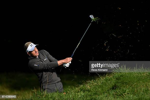 Luke Donald of England plays his second shot on the sixth hole during the first round of the British Masters at The Grove on October 13 2016 in...