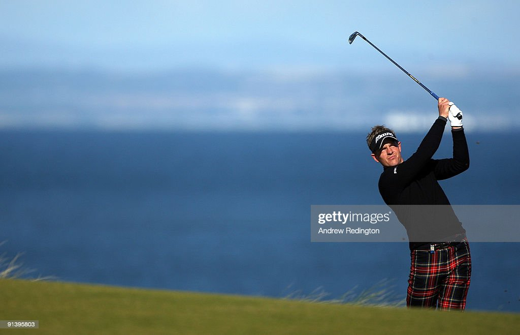 Luke Donald of England plays his second shot to the fifth hole during the third round of The Alfred Dunhill Links Championship at Kingsbarns Golf Links on October 4, 2009 in Kingsbarns, Scotland.The third round was postponed on Saturday due to gale force winds.
