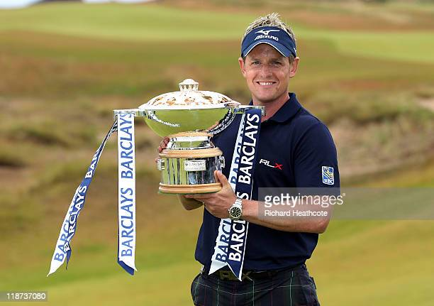 Luke Donald of England poses with the trophy following his victory at the end of the final round of The Barclays Scottish Open at Castle Stuart Golf...