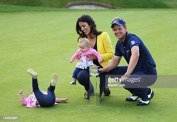 Luke Donald of England poses with the trophy with wife Diane and daughters Elle and Sophia Ann during the final round of the BMW PGA Championship on...