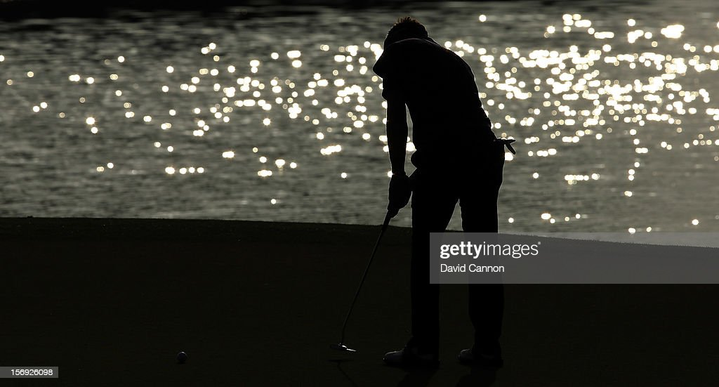 Luke Donald of England putting at the par 4, 16th hole during the final round of the 2012 DP World Tour Championship on the Earth Course at Jumeirah Golf Estates on November 25, 2012 in Dubai, United Arab Emirates.