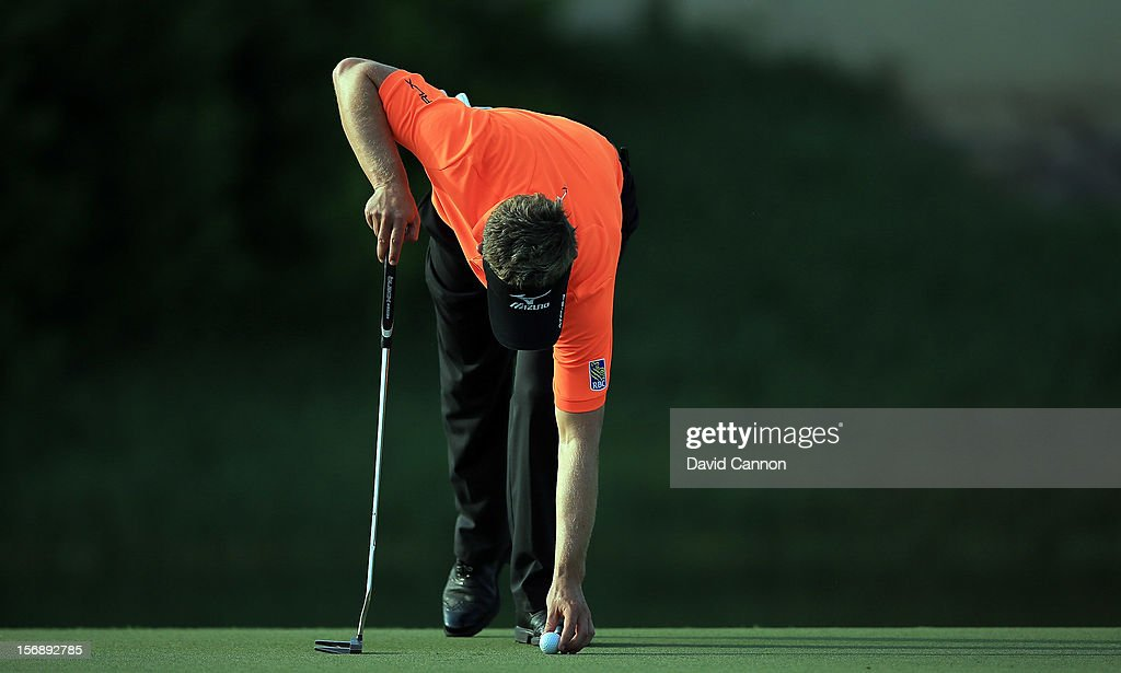 <a gi-track='captionPersonalityLinkClicked' href=/galleries/search?phrase=Luke+Donald&family=editorial&specificpeople=194977 ng-click='$event.stopPropagation()'>Luke Donald</a> of England putting on the 14th green during the third round of the 2012 DP World Tour Championship on the Earth Course at Jumeirah Golf Estates on November 24, 2012 in Dubai, United Arab Emirates.