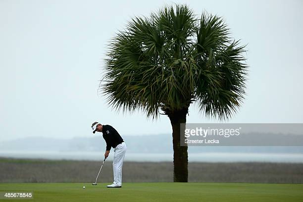 Luke Donald of England putts on the 17th green during the third round of the RBC Heritage at Harbour Town Golf Links on April 19 2014 in Hilton Head...