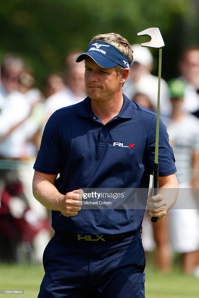 Luke Donald of England reacts after he made a birdie putt on the ninth hole during the second round of the Deutsche Bank Championship at TPC Boston on September 3, 2011 in Norton, Massachusetts.
