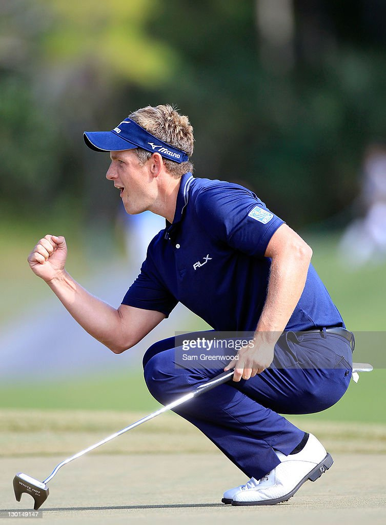 Luke Donald of England reacts after making a birdie putt on the 15th hole during the final round of the Children's Miracle Network Classic at Disney's Magnolia course on October 23, 2011 in Lake Buena Vista, Florida.